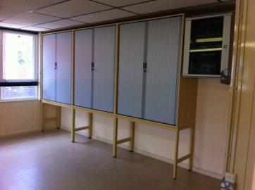 Tambour door storage on framework