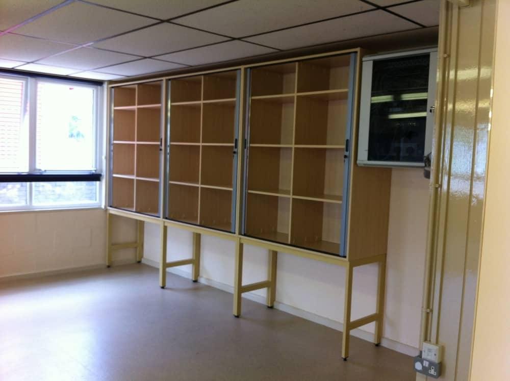 Tambour door storage on framework - open
